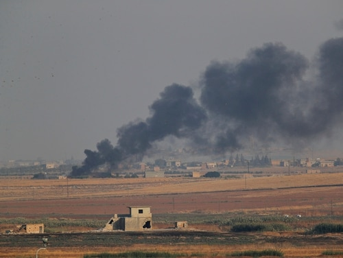 In this photo taken from the Turkish side of the border between Turkey and Syria, in Akcakale, Sanliurfa province, southeastern Turkey, smoke billows from a fire inside Syria during bombardment by Turkish forces Wednesday, Oct. 9, 2019. (Lefteris Pitarakis/AP)