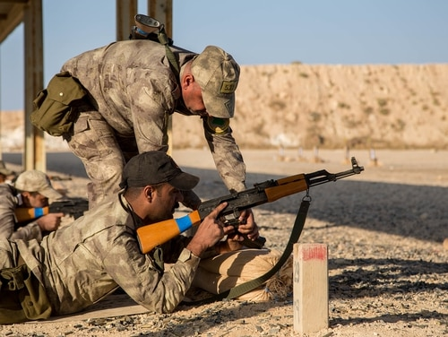 An Iraqi soldier shows a fellow student how to fix an AK-47 assault rifle jam during a live fire rifle range at Al Asad Air Base, Iraq, Oct. 26, 2019. (Spc. Zachary Myers/Army)