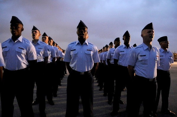 Basic trainees yell out their squadron's motto Apr. 24 before the basic trainees graduate at Lackland Air Force Base, Texas. (U.S. Air Force photo/Staff Sgt. Desiree N. Palacios)