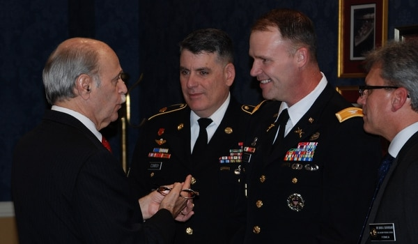 Gene Parent helped find the records necessary to prove Edward Mims' eligibility for the Purple Heart. Parent, from left, talks to Command Sgt. Maj. Martin Conroy, Col. Jason Wolter, the garrison commander of Fort Stewart, Ga., and David Southerland, chief of the military personnel division for Fort Stewart. (Courtesy photo via Lynne Schlichting)