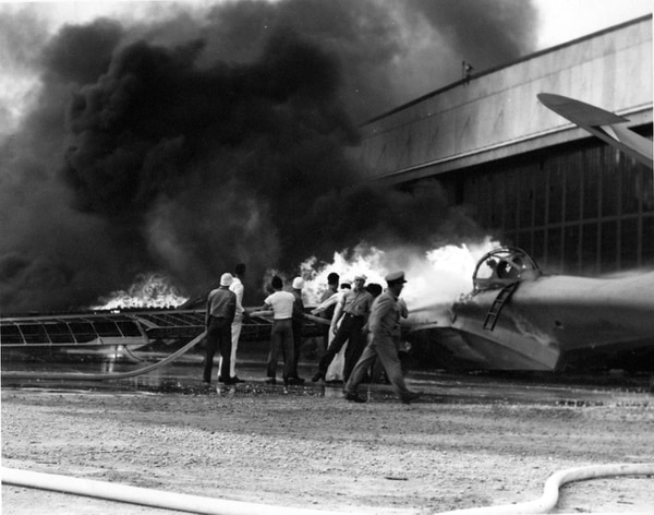 A PBY patrol bomber burning at Naval Air Station Kaneohe, Oahu, during the Japanese attack, 7 December 1941. (National Archives)