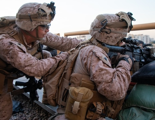 U.S. Marines with 2nd Battalion, 7th Marines, assigned to the Special Purpose Marine Air-Ground Task Force-Crisis Response-Central Command (SPMAGTF-CR-CC) 19.2, reinforce the Baghdad Embassy Compound in Iraq, Jan 1, 2020. (Sgt. Kyle C. Talbot/Marine Corps)