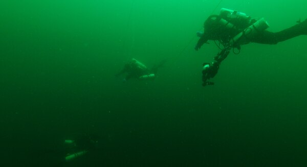 Nomad Exploration Team divers head follow a line toward the ship's wreckage. (Smithsonian Channel/ Nomad Exploration Team)