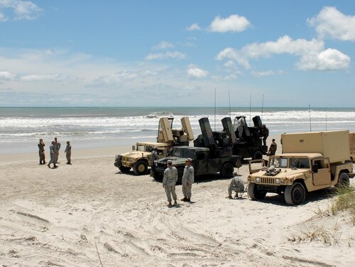 Soldiers from the 108th Air Defense Artillery Brigade, Fort Bragg, N.C,. and Marines from the 2nd Low Altitude Air Defense Battalion, Camp Lejeune, N.C., prepare to conduct a joint live-fire air defense training exercise at Camp Lejeune on June 7, 2016. (Capt. Richard Dickson/U.S. Army)
