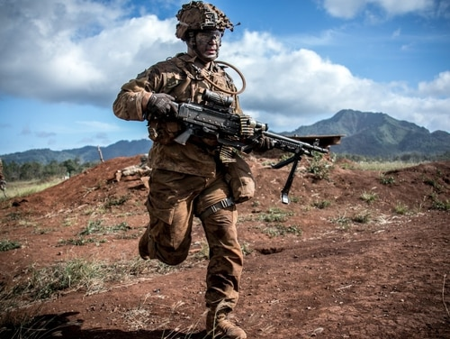 Soldiers assigned to 1st Battalion, 27th Infantry Regiment move forward on an objective during a combined arms live-fire exercise at Schofield Barracks, Hawaii, Aug. 3, 2018. (1st Lt. Ryan DeBooy/Army)