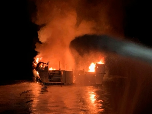 In this photo provided by the Ventura County Fire Department, VCFD firefighters respond to a boat fire off the coast of southern California on Monday. (Ventura County Fire Department via AP)