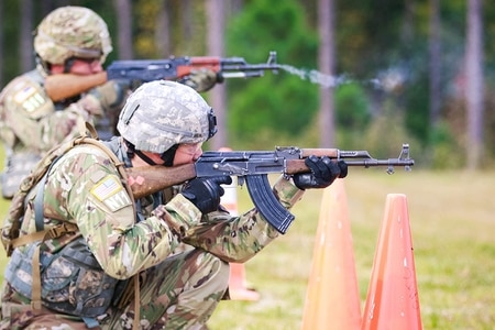 Army Sgt. Kevin Beuse and Spc. Johnny Long, assigned to U.S. Army Cyber Command, simultaneously fire AK-47 assault rifles during the 2017 Best Warrior Competition at Fort A.P. Hill, Va. (Sgt. Steven L. Galimore/U.S. Army)