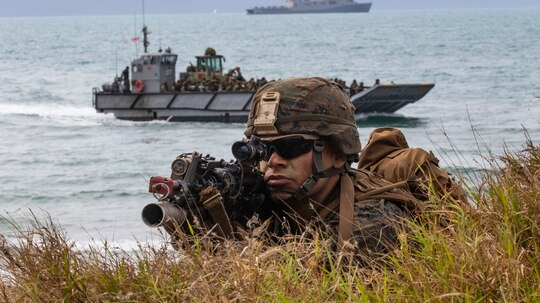 Marine Lance Cpl. Tyler Pearson watches his sector of fire during an amphibious assault on Kings Beach in Bowen, Queensland, Australia, during Exercise Talisman Saber 2019. (Sgt. 1st Class Whitney C. Houston/Army)