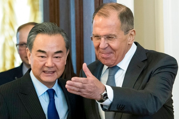 Russian Foreign Minister Sergey Lavrov, right, and China's Foreign Minister Wang Yi enter a hall during their meeting in Moscow on Thursday, April 5, 2018. (Pavel Golovkin/AP)
