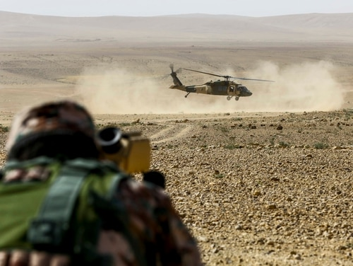 A Jordanian Armed Forces UH-60 Blackhawk with A- Squadron, practice infils and exfils prior to a live fire event during Exercise Eager Lion 16 at Armor Range, Quick Reaction Force, Kingdom of Jordan on May 16, 2016. Eager Lion 16 is a US military bi-lateral exercise with the Hashemite Kingdom of Jordan designed to strengthen relationships and interoperability between partner nations while conducting contingency operations. (U.S. Marine Corps photo by Cpl. Lauren Falk 5th MEB COMCAM/Released)