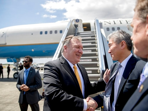 U.S. Secretary of State Mike Pompeo, center, says goodbye to U.S. Ambassador to the Philippines Sung Kim, second from right, as he boards his plane at Colonel Jesus Villamor Airbase in Manila on Friday to travel to Washington. ( ndrew Harnik, Pool/AP)