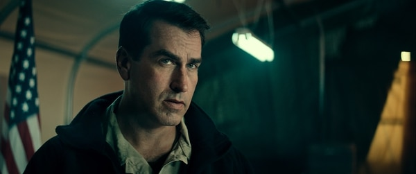 Marine Corps veteran Rob Riggle plays his former boss in