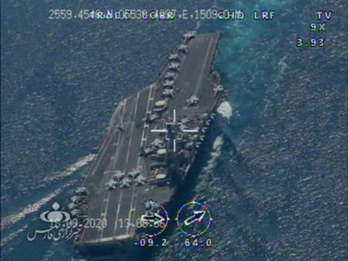 An Iranian drone photo purporting to be the aircraft carrier Nimitz transiting the Strait of Hormuz. (Iran via INTELSky)