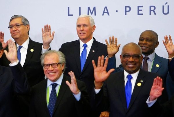 U.S. Vice President Mike Pence, center, waves along with other heads of state, during the official photo of the Summit of the Americas in Lima, Peru, Saturday, April 14, 2018. (Karel Navarro/AP)