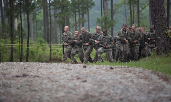 U.S. Army soldiers negotiate the Darby Queen obstacle course during the Ranger Course on Fort Benning, Ga., April 26, 2015. Soldiers attend the Ranger Course to learn additional leadership and small unit technical and tactical skills in a physically and mentally demanding, combat simulated environment. (U.S. Army photo by Spc. Nikayla Shodeen/Released)