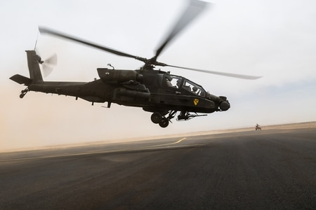 An AH-64 Apache operated by the U.S. Army's 4th Battalion, 227th Attack Reconnaissance Battalion, 42nd Combat Aviation Brigade, and Royal Saudi Land Forces personnel from 1st Battalion, 3rd Aviation Group, takes off at the start of a practice air assault during Exercise Friendship and Iron Hawk 14 on April 12, 2014, near Tabuk, Saudi Arabia.(U.S. Army)