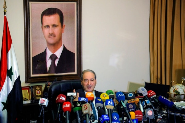 This photo released by the Syrian official news agency SANA, Syrian Deputy Foreign Minister Faisal Mekdad, speaks during a news conference in Damascus, Syria, Saturday, March 10, 2018. Mekdad denied opposition charges that government forces used poison gas in their attacks on eastern Ghouta. Mekdad added that insurgents groups in the eastern Ghouta are preparing