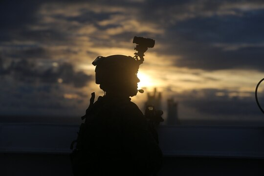 Marine Lance Cpl. Steven Rowe posts security during a visit, board, search, and seizure training as part of exercise HYDRACRAB, Santa Rita, Guam, Aug. 27, 2019. (Kelly Rodriguez/Marine Corps)