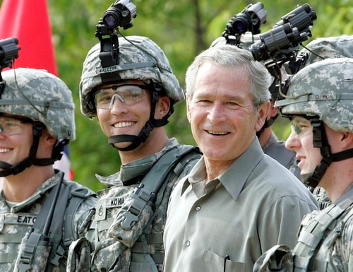 President Bush smiles as he poses for a group photo with military personnel during his visit to U.S. Army Special Operations Command at Fort Bragg, N.C., on July 4, 2006. (AP Photo/Pablo Martinez Monsivais)