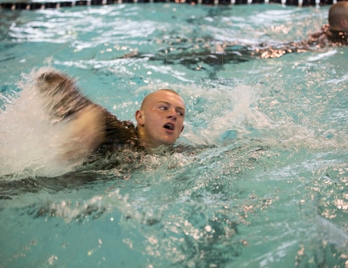 A Marine recruit swims 25 meters during water survival training at Parris Island, South Carolina. (Cpl. Vanessa Austin/Marine Corps)