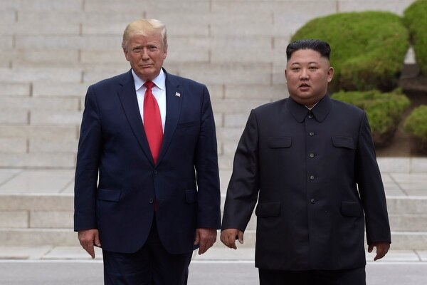 President Donald Trump meets with North Korean leader Kim Jong Un at the North Korean side of the border at the village of Panmunjom in Demilitarized Zone, Sunday, June 30, 2019. (Susan Walsh/AP)