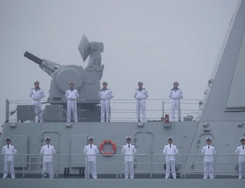 Sailors stand on the deck of the Type 055 guide-missile destroyer Nanchang as it participates in a parade on April 23, 2019. (Mark Schiefelbein/AFP via Getty Images)
