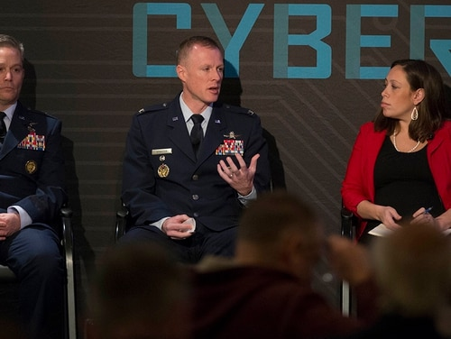 Brig. Gen. Timothy Haugh, left, Director of Intelligence, U.S. Cyber Command at Fort Meade, MD, with Col. Todd Stratton, center, Director, AFCYBER Forward, in a panel on Fighting Terror in Cyberspace moderated by Amber Corrin, right, Sr. Reporter, C4ISRNet, during Cybercon 2017 at the Ritz-Carlton Hotel in Pentagon City on Nov. 28, 2017. (Alan Lessig/Staff)