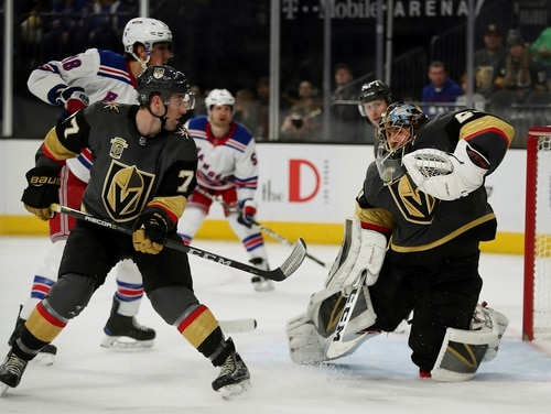 Vegas Golden Knights goaltender Marc-Andre Fleury, right, blocks a shot during the team's game on Sunday in Las Vegas. The Army is challenging the team's use of its name, logo and color scheme. (L.E. Baskow/AP)
