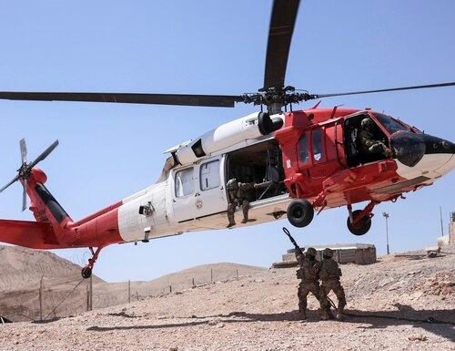 U.S. soldiers hook a sling-load to a Task Force Sinai UH-60 Black Hawk at a remote site, Sept. 12, 2019. (Capt. Mark Scott/Army)