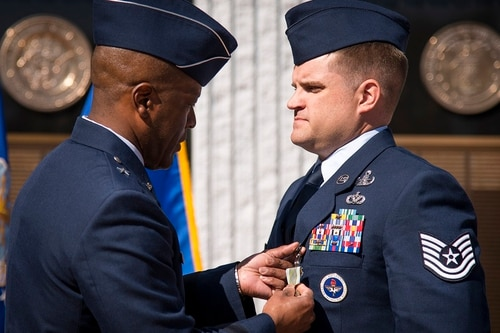 Brig. Gen. Ronald Jolly, 82nd Training Wing commander, pins the Airman's Medal onto Tech. Sgt. Phillip Dyer during a ceremony on March 9 at Eglin Air Force Base, Florida. (Samuel King Jr./Air Force)
