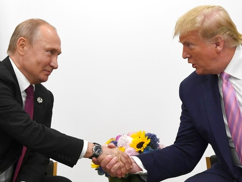 President Donald Trump, right, shakes hands with Russian President Vladimir Putin during a bilateral meeting on the sidelines of the G-20 summit in Osaka, Japan, on June 28, 2019. (Susan Walsh/AP)