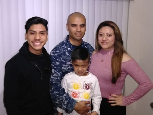 Ship's Serviceman 2nd Class Juan Quiroz is getting ready to deploy this summer. At the same time, his immigrant wife, Irais, faces a deportation order, raising fears she will be kicked out of the country while he is underway. They are shown here with their two sons. (Photo courtesy Juan Quiroz)