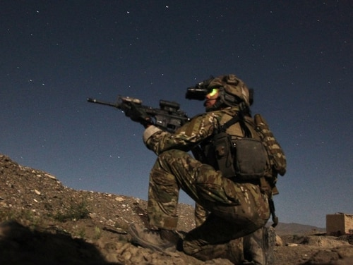 A member of an Afghan and coalition security force utilizes a night vision device while providing security during an operation in Paktiya province, Afghanistan. (Pfc. Codie Mendenhall/Army)