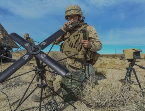 U.S. Marine Corps Cpl. Cameron J. Rider, a radio operator with Combat Logistics Regiment 1, 1st Marine Logistics Group, establishes satellite communication with the combat operations center using a distributed tactical communications system in 29 Palms, California, Dec. 8th, 2019, during exercise Steel Knight. (Pfc. Ulises Salgado/Marine Corps)