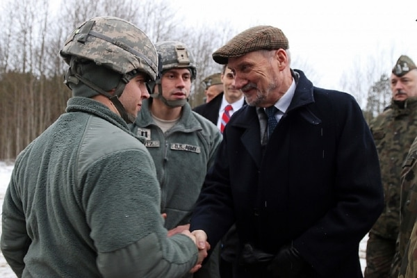 Then Polish defense minister, Antoni Macierewicz, shakes hands with soldiers in a Patriot unit. Macierewicz was working to finalize a deal to buy Patriot systems from the U.S. government when he visited the 5th Battalion, 7th Air Defense Artillery Brigade in Poland to view 5-7 ADA's M901 Patriot Launching Stations. Macierewicz was replaced as defense minister in January 2018. (Photo by Sgt. Paige Behringer/10th Press Camp Headquarters)