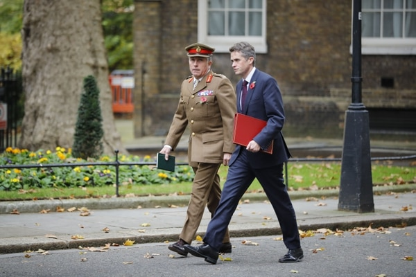 Chief of the Defence Staff Gen. Nick Carter, left, walks with British Defence Secretary Gavin Williamson in Downing Street on Nov. 6, 2018. (Tolga Akemn/AFP via Getty Images)