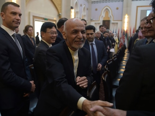 Afghan President Ashraf Ghani shakes hands with a foreign delegate at the second Kabul Process conference at the Presidential Palace in Kabul on Feb. 28, 2018. (Shah Marai/AFP via Getty Images)
