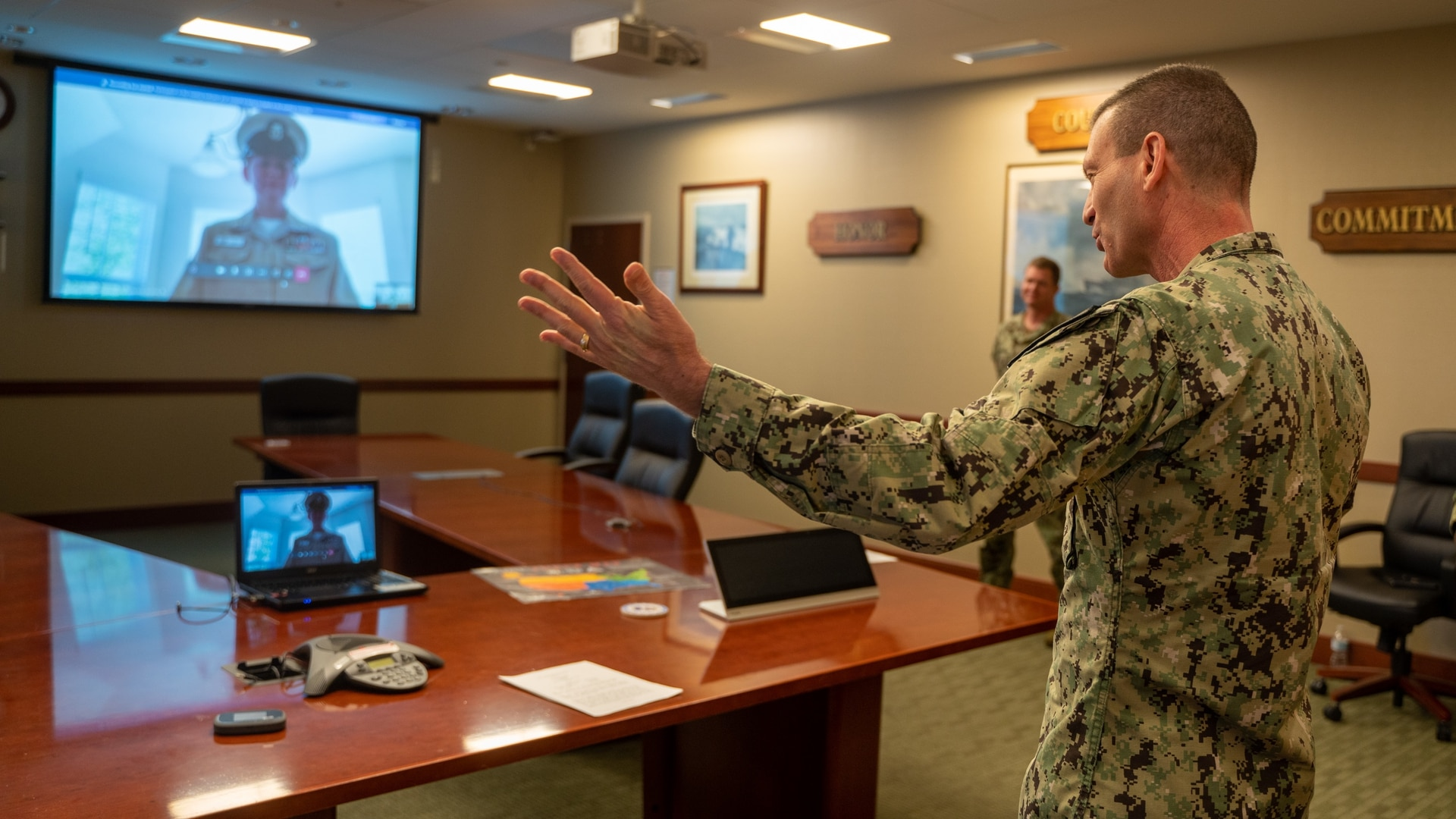 Rear Adm. John Schommer, the head of Navy Reserve Forces Command, congratulates newly frocked senior and master chiefs using remote work software that the Pentagon fast-tracked during the coronavirus pandemic. (Petty Officer 1st Class Arthurgwain Marquez/U.S. Navy)