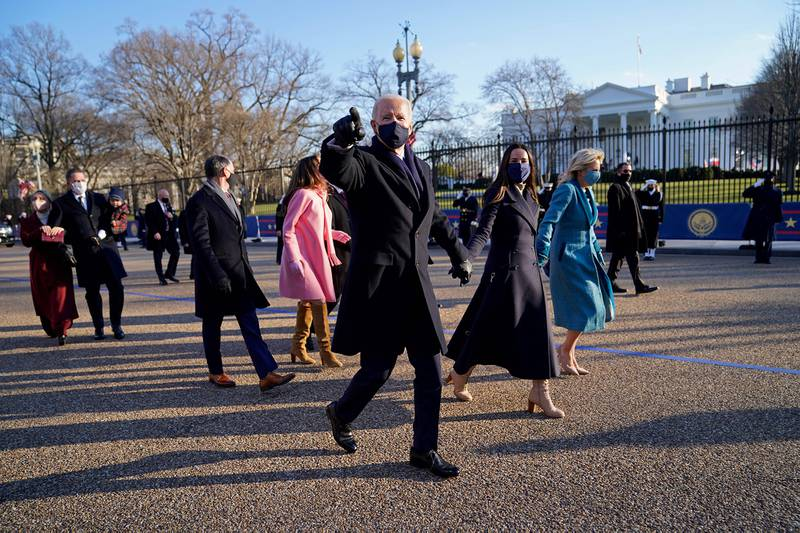 President Joe Biden and first lady Jill Biden walk up Pennsylvania Avenue towards the White House in Washington after Biden and Kamala Harris were sworn in at the Capitol on Jan. 20, 202.