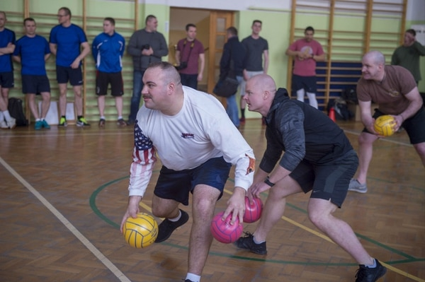 Personnel from the Naval Support Facility Redzikowo, the Polish Force Protection Battalion at the base in Redzikowo, and the Police School in Slupsk compete in a dodge ball tournament at the Commander's Cup in March 2018. NSF Redzikowo is the Navy's newest installation and the first U.S. installation in Poland. (Lt. Josie Lynne Lenny/Navy)