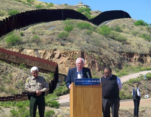Democratic presidential candidate Bernie Sanders speaks near the U.S.-Mexico international border in Nogales, Ariz., Saturday, March 19, 2016. Sanders said he will fight for immigration reform as he stood near the border fence that divides Arizona and Mexico. (AP Photo/Astrid Galvan)