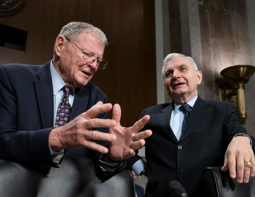 Senate Armed Services Committee ranking member Jim Inhofe, R-Okla., left, and Chairman Jack Reed, D-R.I., confer before a hearing on the Pentagon budget on Capitol Hill on March 14, 2019, when their leadership positions were reversed. (J. Scott Applewhite/AP)