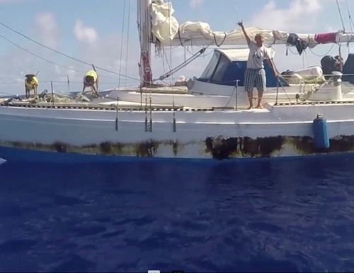 In this Wednesday, Oct. 25, 2017, still image taken from video provided by the U.S. Navy, Jennifer Appel, of Honolulu, holds up a shaka sign as rescuers approach her crippled sailboat, the Sea Nymph, after being lost at sea for months, about 900 miles southeast of Japan. Their engine was crippled, their mast was damaged and things went downhill from there for two women who set out to sail the 2,700 miles from Hawaii to Tahiti. A Taiwanese fishing vessel spotted their boat off Japan and thousands of miles in the wrong direction from Tahiti. The Navy sent the USS Ashland to their rescue. (U.S. Navy via AP)