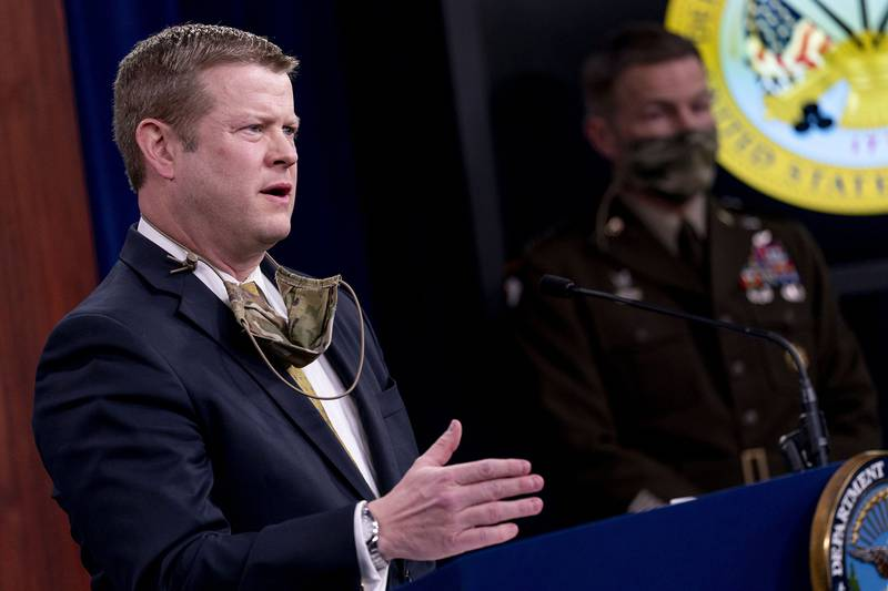Secretary of the Army Ryan McCarthy, left, accompanied by Gen. James McConville, chief of staff of the Army, right, speaks during a briefing on an investigation into Fort Hood, Texas, at the Pentagon, Tuesday, Dec. 8, 2020, in Washington.