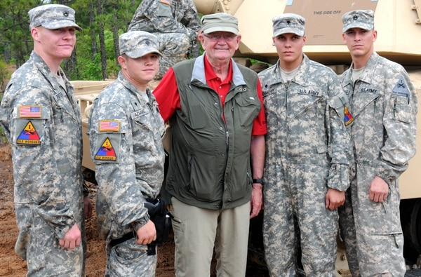 Pfc. Wesley Adams, Spc. Michael Adams, Spc. Grant Vonmoss, and Sgt. 1st Class Marc Westenbarger, an armor tank crew from C Company, 1st Battalion, 77th Armor Regiment, 4th Brigade Combat Team, 1st Armored Division, pose for a photograph with (ret.) Gen. Gordon R. Sullivan, the 32nd Chief of Staff, during the inaugural Sullivan Cup precision tank gunnery competition May 10 held at Fort Benning, Ga. The competition, named after the 36-year armor veteran, gathered 15 of the Army's top tank crews for a four-day tank competition that included tank and weapon maintenance, simulators, and live-fire engagements.