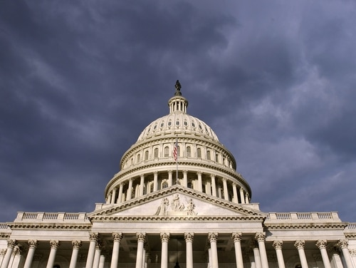 Dark clouds pass over the Capitol in Washington, D.C., on Oct. 1, 2013, when the last government shutdown began. (Susan Walsh/AP)