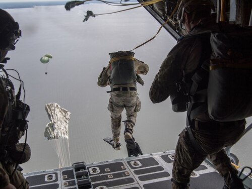 Air Force Special Tactics operators conduct a static line jump out of a C-130H Hercules following a Rigged Alternate Method Boat package into the water during training at Eglin Range, Fla., Aug. 21, 2020. (Tech. Sgt. Rose Gudex/Air Force)