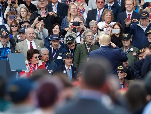 President Donald Trump is considering Veterans Day pardons for some service members charged with or convicted of war crimes, but Pentagon officials say Defense Secretary Mark Esper will ask him to reconsider. Pictured: Trump salutes to veterans prior to a ceremony to mark the 75th anniversary of D-Day at the Normandy American Cemetery in Colleville-sur-Mer, Normandy, France, on June 6, 2019. (Thibault Camus/AP)