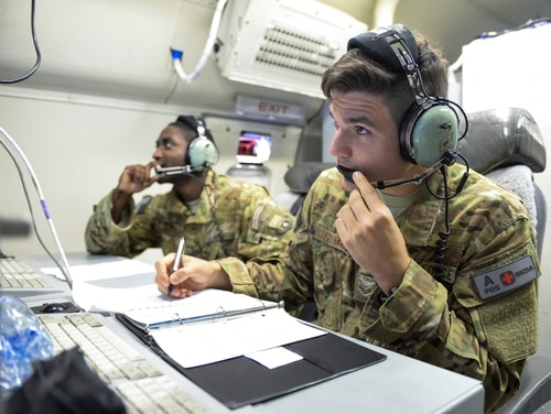 U.S. Air Force Senior Airmen Mehmet Yasdiman, foreground, and William Pryor, communications system technicians assigned to the 7th Expeditionary Airborne Command and Control Squadron, study their computer monitors during a mission aboard an E-8C Joint Surveillance Target Attack Radar System aircraft out of Al Udeid, Air Base, Qatar, July 27, 2017. The E-8C JSTARS aircraft and crew provide essential battle management, command and control, intelligence, surveillance and reconnaissance capabilities in support of Operations Inherent Resolve and Freedom's Sentinel. (U.S. Air National Guard photo by Tech. Sgt. Bradly A. Schneider/Released)