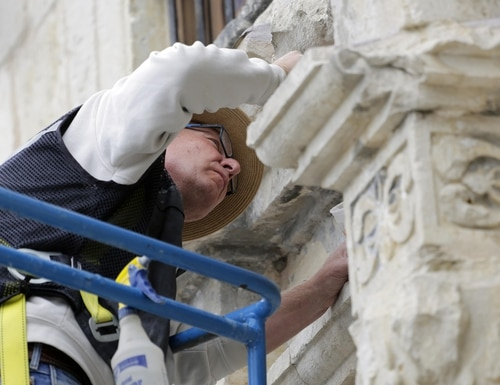 Ivan Myjer, a stone conservator based in suburban Boston who has helped restore historic sites around the world. make repairs to the Alamo, Thursday, Oct. 29, 2015, in San Antonio. The Alamo is undergoing $5 million in emergency repairs, part of a sweeping, state Legislature-approved $31.5 million makeover that may be one of the site's most-ambitious since the days of Davy Crockett. (AP Photo/Eric Gay)